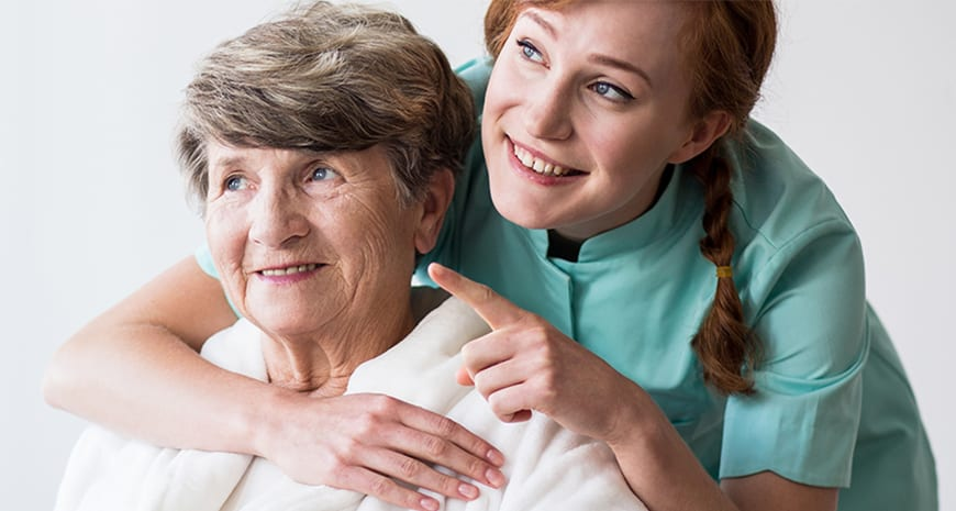 carer and elderly smiling